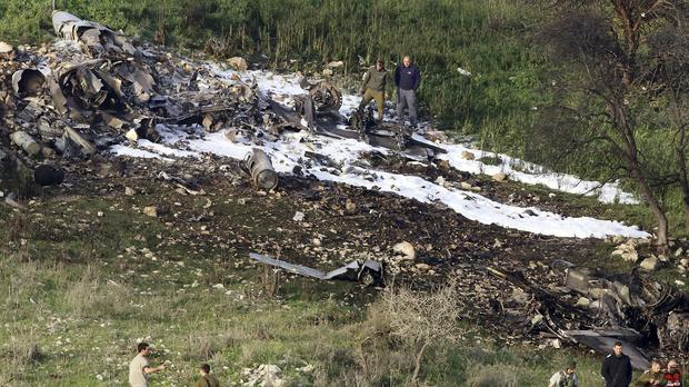 Israeli security by the wreckage of an F-16 plane. (Rami Slush/AP)