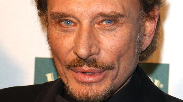 Hallyday left all his property and artistic rights to his widow, Laeticia