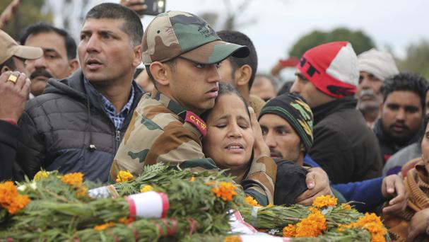 The family of Indian army soldier Madan Lal Choudhary attend his funeral after the weekend attack (AP)