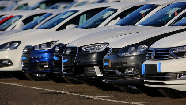 New car sales in Britain are falling (PA)