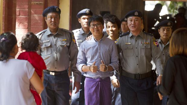 The journalists at a previous court hearing (Thein Zaw/AP)