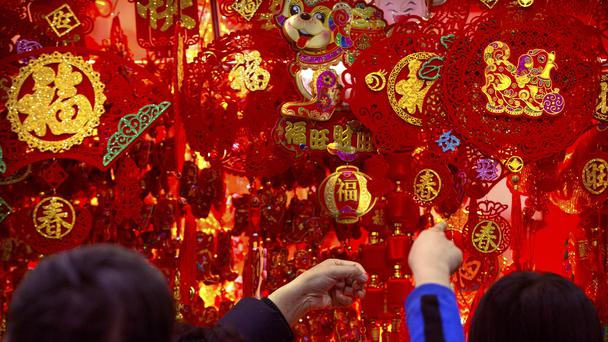 Customers shop for Lunar New Year decorations at a wholesale market in Beijing (Mark Schiefelbein/AP)