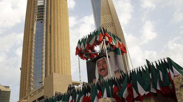 A picture of Kuwait's ruling emir, Sheikh Sabah Al Ahmad Al Sabah at the conference venue for the reconstruction of Iraq (Jon Gambrell/AP)