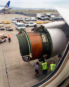 This photo provided by passenger Haley Ebert shows damage to an engine after parts came off the jet during the flight. Photo: AP