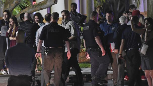 Parents pick up their children at a hotel after the shooting (Jim Rassol/Sun-Sentinel/AP)