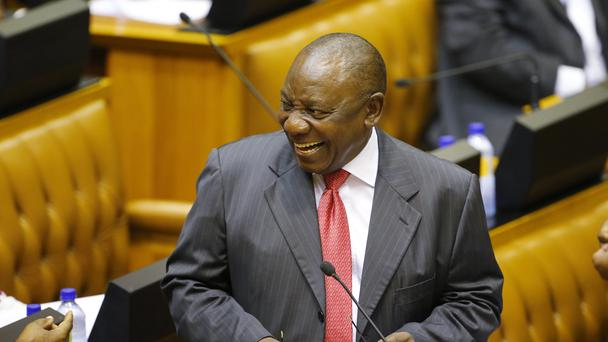 Cyril Ramaphosa smiles while he listens to a debate in Parliament (Mike Hutchings/AP)