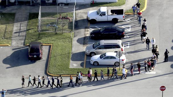 Students are evacuated from the shooting scene (Sun Sentinel/AP)