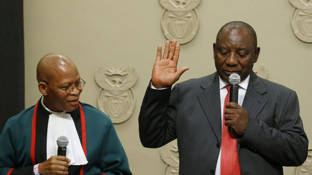 Cyril Ramaphosa is sworn in as South African President by Chief Justice Mogoeng Mogoeng, (Mike Hutchings/AP)