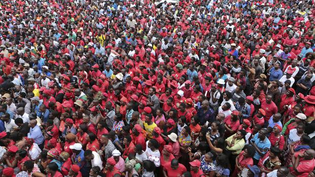 Opposition supporters in Zimbabwe listen to Nelson Chamisa's speech following the death of Morgan Tsvangirai (Tsvangirayi Mukwazhi/AP)