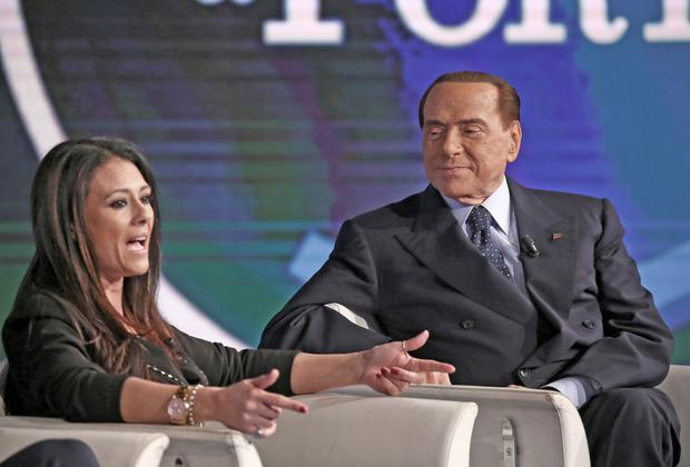 Italy's former prime minister Silvio Berlusconi listens as Forza Italia candidate Giusy Versace speaks during the recording of talk show 'Porta a Porta' (Door to Door) in Rome. Photo: Reuters