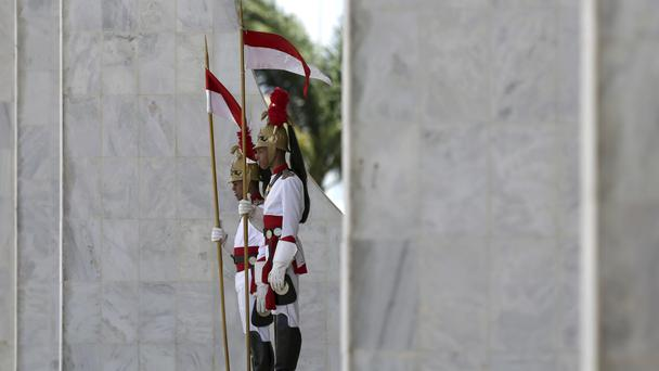 Presidential guard soldiers stand at the Presidential Palace (AP Photo/Eraldo Peres)