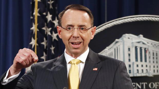 Deputy attorney general Rod Rosenstein announces the charges in Washington (Jacquelyn Martin/AP)