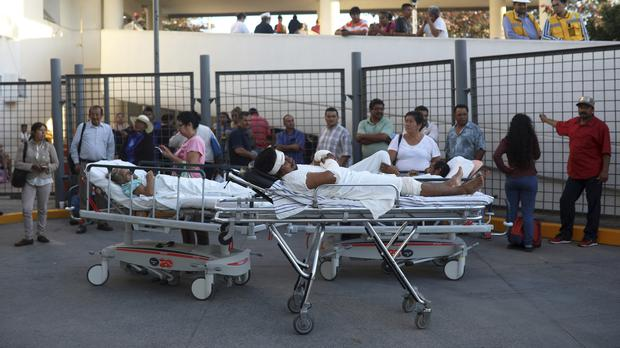 Patients were evacuated from the General Hospital in Veracruz, Mexico, after the earthquake (Felix Marquez/AP)