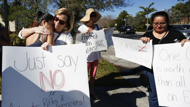 Protesters hold up anti-gun signs in Parkland, Florida (Brynn Anderson/AP)