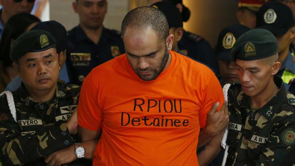 Fehmi Lassoued, also known as John Rasheed Lassoned, is arrested in Manila (AP)