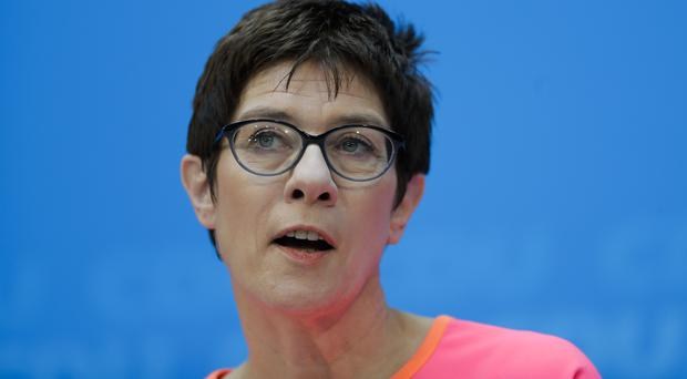 The governor of German Saarland state and designated CDU Secretary General, Annegret Kramp-Karrenbauer, addresses a news conference after a party's leaders meeting in Berlin (AP)