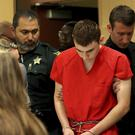 Nikolas Cruz appears in court for a status hearing before Broward Circuit Judge Elizabeth Scherer (Mike Stocker/Sun-Sentinel/AP)