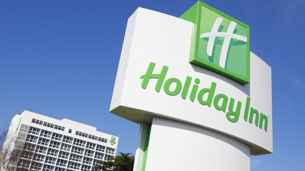 Holiday Inn owner InterContinental Hotels Group announced aims to slash costs to reinvest in a new growth plan as it posted higher annual earnings.