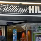 William Hill breached anti-money laundering and social responsibility regulations, a Gambling Commission investigation found (John Stillwell/PA)
