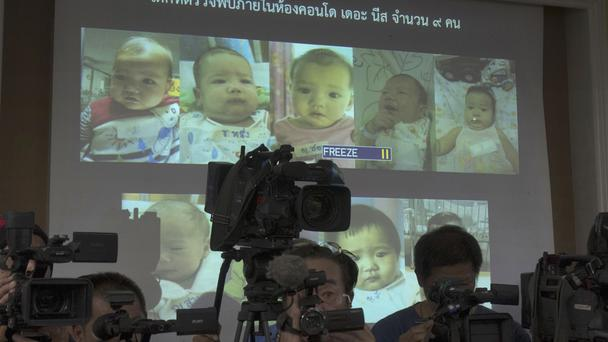 Images of surrogate babies born to a Japanese man who has been granted custody of 13 children he fathered (AP)