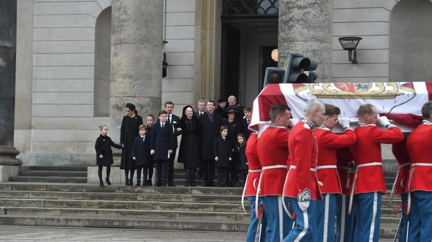 The Danish royal family look on as pallbearers carry the coffin of Prince Henrik during the funeral ceremony (AP)