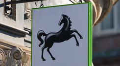 Lloyds Banking Group has delivered a £3.2 billion bumper payout for investors and handed its boss a £6.4 million pay package after reporting a record annual profits haul.