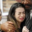 Aria Siccone, 14, a survivor from Marjory Stoneman Douglas High School, cries as she recounts her story from that day, while state Rep. Barrinton Russell comforts her (AP)