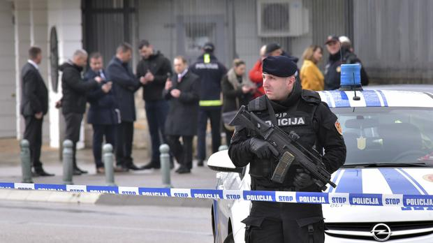A police officer guards the US embassy in Montenegro's capital Podgorica (AP Photo/Risto Bozovic)