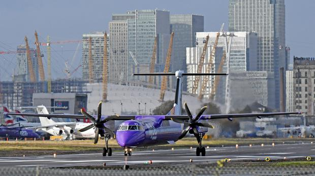 A Flybe plane prepares to take off at London City Airport (PA)