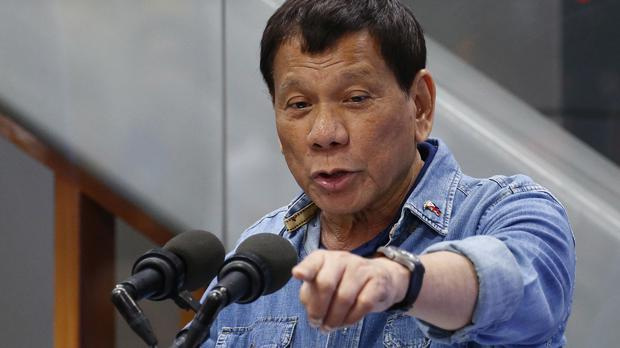 Philippine President Rodrigo Duterte has banned a critical reporter from his presidential palace news briefings (AP Photo/Bullit Marquez)