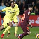 Villarreal's Ruben Semedo, left, challenging Barcelona's Lionel Messi in December last year (AP Photo/Alberto Saiz, File)