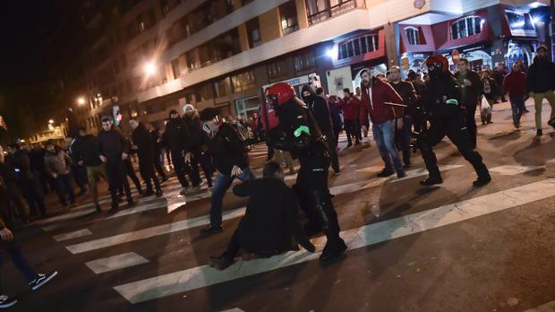 Basque riot police clash with followers of Athletic Bilbao and FC Spartak Moskva before the match at San Mames stadium, in Bilbao (Alvaro Barrientos/AP)