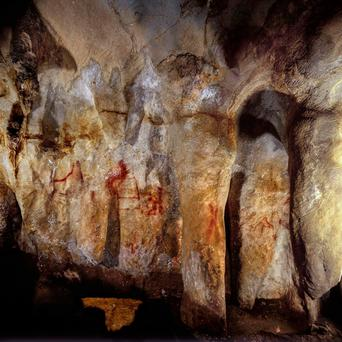 Paintings on a section of the La Pasiega cave wall in Spain which pre-date modern humans by many thousands of years