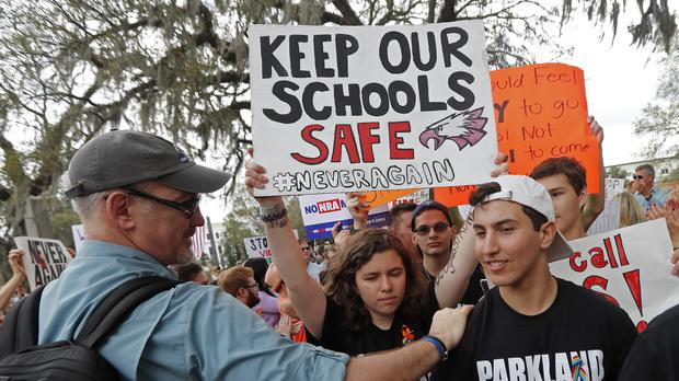 Student survivors from Marjory Stoneman Douglas High School are greeted as they arrive at a rally for gun control reform on the steps of the state capitol (Gerald Herbert/AP)