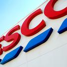 A Tesco sign, as the £3.7 billion takeover of Booker faces a crunch vote (PA)
