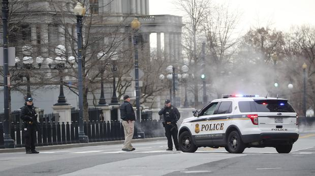 Police block 17th Street near the White House