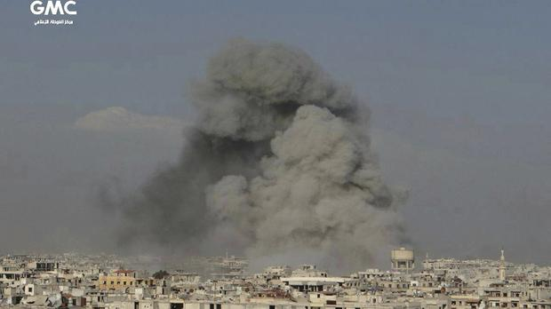 Smoke rises after Syrian government air strikes hit Ghouta (Ghouta Media Centre via AP)