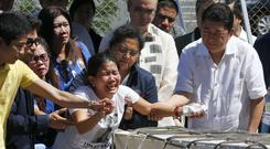 Grief as the casket of Joanna Demafelis arrives at the Ninoy Aquino International Airport (AP Photo/Bullit Marquez)