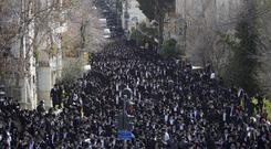 Tens of thousands of ultra-Orthodox Jews attend the funeral procession of Shmuel Auerbach (Ariel Schalit/AP)