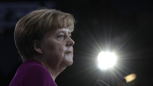 German chancellor and party chairwoman Angela Merkel delivers her speech to the Christian Democratic Union in Berlin (AP)