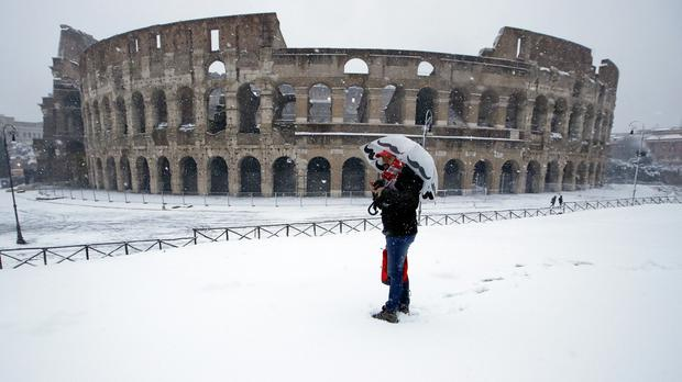 A very rare sight in front of the ancient Colosseum - a blanket of snow (AP)