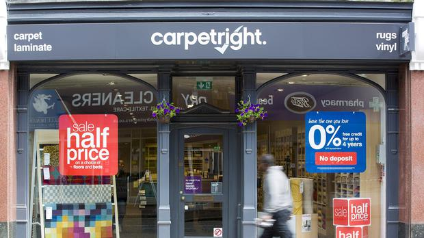 Carpetright has warned it is set to swing to a full year loss and has started talks with its lenders (Carpetright/PA)