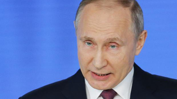 Vladimir Putin delivers his annual state of the nation address in Manezh, Moscow (AP)