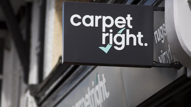 Carpetright shares have tanked after it warned over profits for the second time since Christmas and said it had started talks with its lenders.
