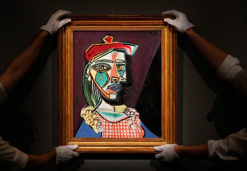 Sotheby's employees hold up one of Pablo Picasso's portraits of his muse Marie-Theres Walter. Photo: AP