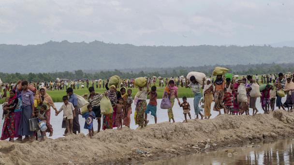 Rohingya Muslims have crossed into Bangladesh in their thousands (AP)
