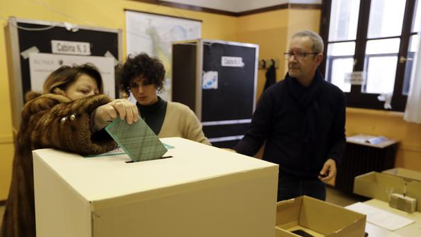 A voter casts her ballot in Rome (Andrew Medichini/AP)