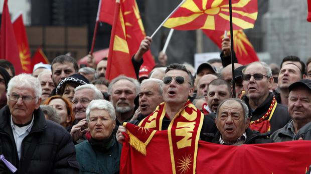People chant Macedonia during a protest against the change of the country's constitutional name, in Skopje, Macedonia (Boris Grdanoski/AP)