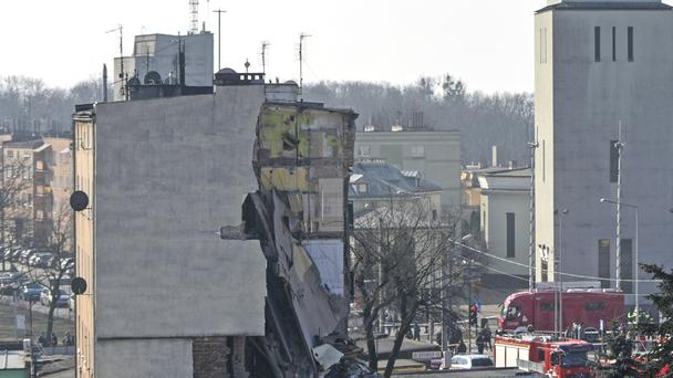 Rescuers work at a collapsed building in Poznan, Poland (AP)