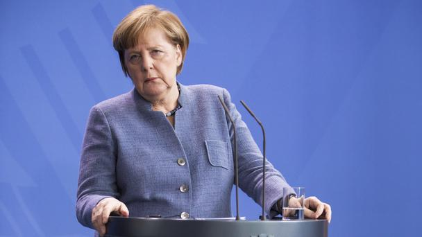 Parliament is expected to meet on March 14 to re-elect Ms Merkel as chancellor (Kay Nietfeld/dpa via AP)